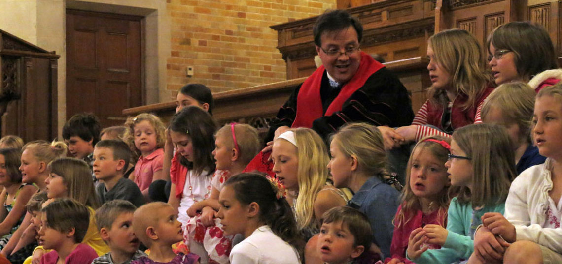 Reverend Dr. Paul H. Lang with Children from FPC Fargo